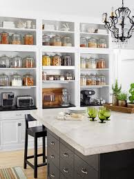 big storage for diy small kitchen with green glass side white plates closed green tree on nice planter plus black chair and interesting chandelier
