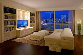 living room large trendy living room photo in other with beige walls build living room built ins