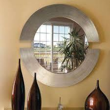 round orbit silver leaf mirror
