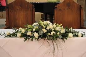 Imagini pentru top table flower arrangements for weddings