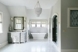 white and gray bathroom with white beaded chandelier