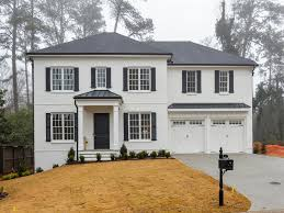 Amazing White Painted Brick With Luver Shutters, Painted Metal Roofs And Round  Downspouts