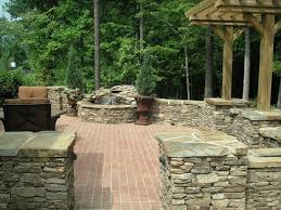 Small Picture A manufactured brick patio surrounded with natural stone pillars