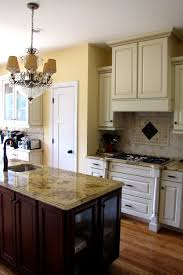 Granite With Cream Cabinets Kitchen Lapidus Granite Travertine Tile Cream Cabinets With