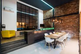 industrial loft lighting. Lit Up Open Plan Kitchen And Dining Area With Brick Wall In Budapest Loft Apartment | Industrial Lighting