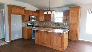 red oak cabinetry with granite countertops vinyl plank flooring and bronze accents this home is being custom built to move to lake eufaula