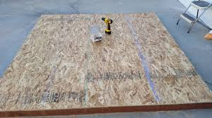 the wood floor is framed with pressure treated 2 4 lumber onto which i placed oriented strand board osb flooring since the floor is 7 x 7 foot