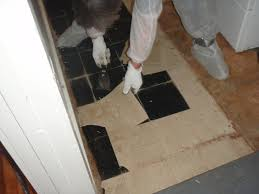 ... Glue that attaches floor tiles to concrete or wood (also called