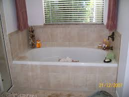 amazing soaker tub with bathtub surround and wall tile also window treatments