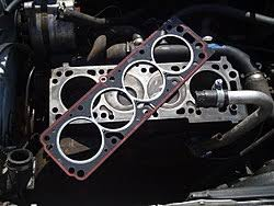head gasket. a replacement head gasket sitting loosely on top of four-cylinder 1989 vauxhall astra engine block. once positioned correctly the cylinder will be wikipedia