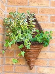 wall mounted wicker baskets cone shaped wicker wall mounted flower planter photo by wall mounted wicker wall mounted wicker baskets