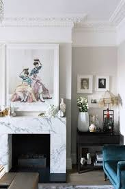small white living room with marble fireplace
