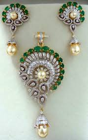 beautiful pendant set studded with round tapers pear shaped diamonds with emeralds pearls