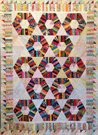 quilt retreat » Stash Bandit & Here's something more complex. This is Honeycomb by Karen Griska of the  Selvage Blog. The 60º triangles that make up the hexagons are first string  pieced. Adamdwight.com