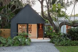 this gabled addition by upstairs studio architecture is topped with a standing seam metal roof and
