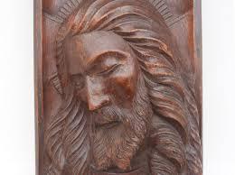 carved wood panel sculpture