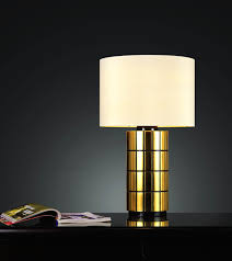 small contemporary best bedside table lamp with gold stand cover and white round lampshade on black table with bookshelf ideas