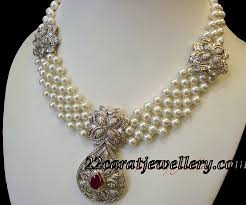 pearl necklace with white gold diamond pendant