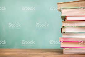 school desk background.  Desk Textbooks Stacked On School Desk With Chalkboard Background Royaltyfree  Stock Photo With School Desk Background D