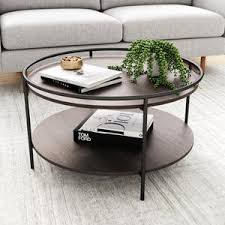 Round up country chic style for your living room repertoire with this 3 piece coffee table set. Paloma Round Coffee Table For Tea Or Cocktail 2 Tier Minimalist Tray Top Edge Dark Oak Matte Black Nathan James
