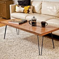 simple minimalist wood hairpin legs coffee table with dark-painted legs a  cup of black