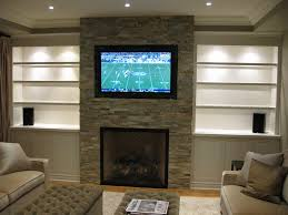 basement home theater with fireplace. home theater and storage cabinets with brick fireplace basement n
