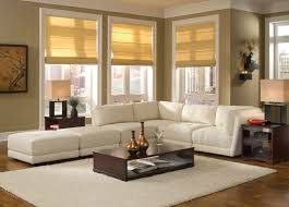 contemporary living room with white leather sectional sofa also hardwood floor with area rug ideas and beige sectional living room