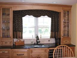 Decorating Kitchen Windows Kitchen Bay Window With Colorful Curtain Ideas And Wooden Cabinet