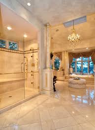 elegant luxury master bathroom with glass shower and chandelier