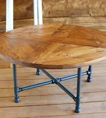 kosas kinda reclaimed wood round coffee table pattern with pipe legs features sun 1 0 dsc