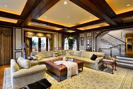 craftsman living room with backlit beam ceiling wood molding and large area rug