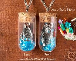 jewellery themed glass vial pendant