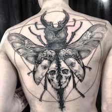 крутое тату скарабея на спине мужчины фото рисунки эскизы