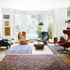living room with multiple patterned rugs how rugs can revitalise living rooms living room