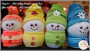 create easy diy sock snowmen this year as your holiday craft in your classroom for an