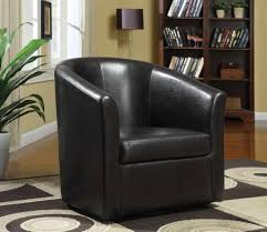 black leather swivel chairs for traditional living room design with small bookcase and lamp stand