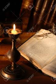stock photo vine still life with old book near lighting candle