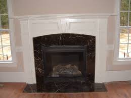 outstanding living room decoration using aged light brown for great black fireplace surround