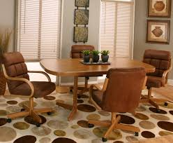 dining room chairs with wheels. Home Interior: Hurry Kitchen Table With Swivel Chairs Casual Sunset Oak Finished Dining 4 Chenille Room Wheels
