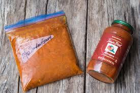 24 ounce of sunday gravy in a ziplog and a jar of marinara sauce