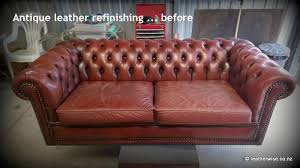 the owner of this deep oned leather sofa had just finished redecorating the interior of his home and decided that this sofa needed the same treatment