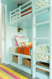 turquoise bunk beds with pink and and orange bedding