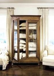 armoire glass doors medium size of add storage with an town country living with glass doors