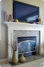 33 shades of green decorating around the tv for adorable decor above fireplace mantel