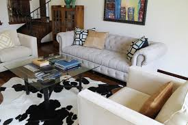 apartment living room rug. Contemporary Living Room Design For Small Apartment Ideas With Cowhide Rug And Tufted Chesterfield Sofa