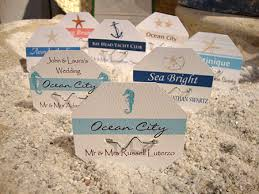 custom beach badges for beach weddings with table numbers and Wedding Escort Cards And Table Numbers wedding beach badges for beach wedding escort cards and placecards DIY Wedding Table Cards