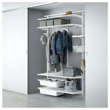 white wall mounted closet storage system with grey baskets behind sliding door wall mounted closet