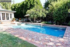 pool patioore love the brick around this pool more pool patios concrete pool patioore