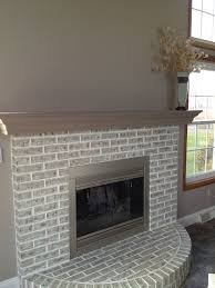 completed fireplace painted over red brick