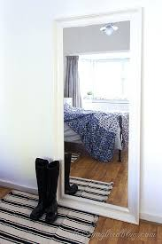mirror in bedroom black boots in front of a large mirror in bedroom with blue bedding mirror in bedroom